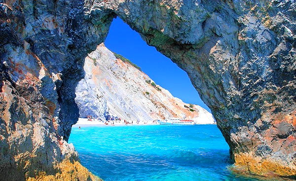 View of the beach through a rock formation SKIATHOS PHOTO GALLERY - BEACH THROUGH THE ROCK